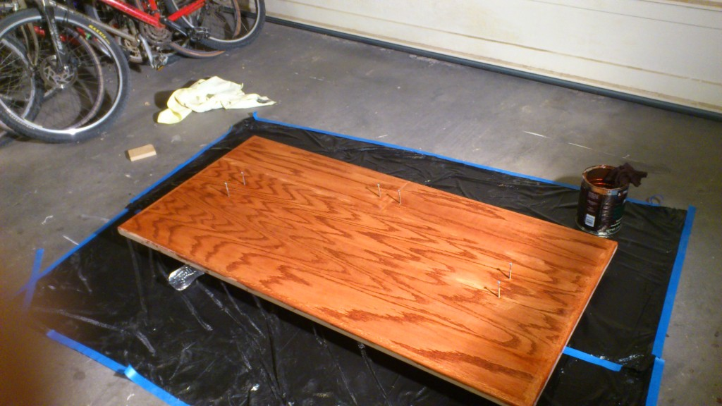 After a few coats of wipe-on poly. There are 9 coats total. The staining wasn't done very well, and it became very uneven and mixed with the first two coats of poly